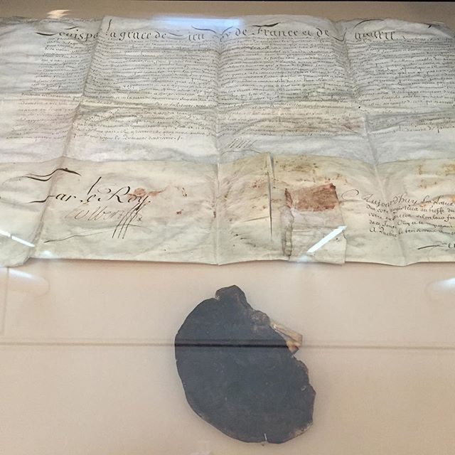 Denonville Commission, 328 year-old parchment signed with official wax seal of King Louis XIV, granting Marquis De Denonville near limitless power to bring war to the Onöndowa'ga:' (Seneca) in 1687. On display at new Seneca Art & Culture Center @ganondagan.